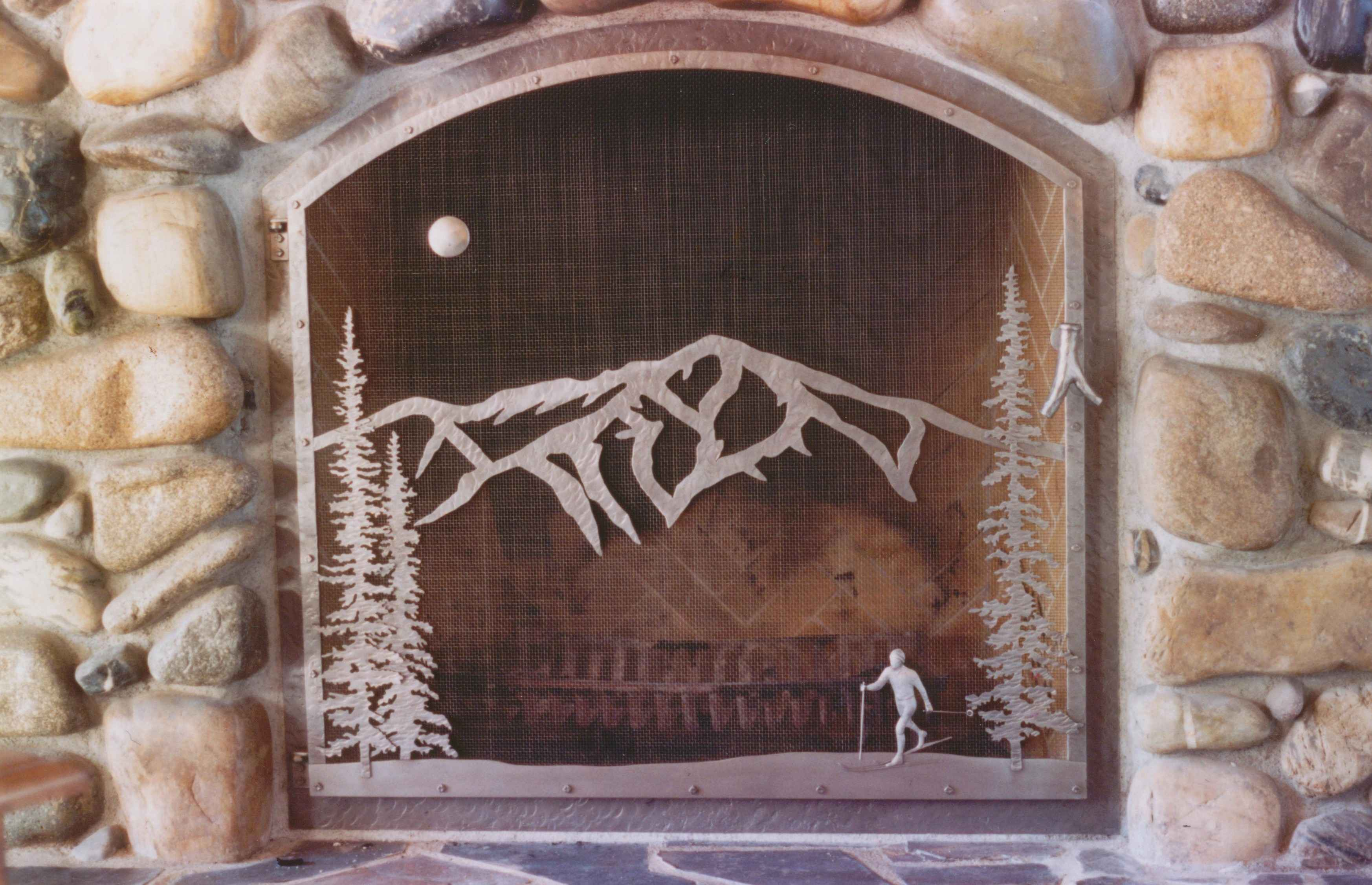 Bald mountain with skier fire screen